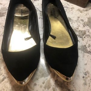 NWOT! Black flats with gold decal on the toes